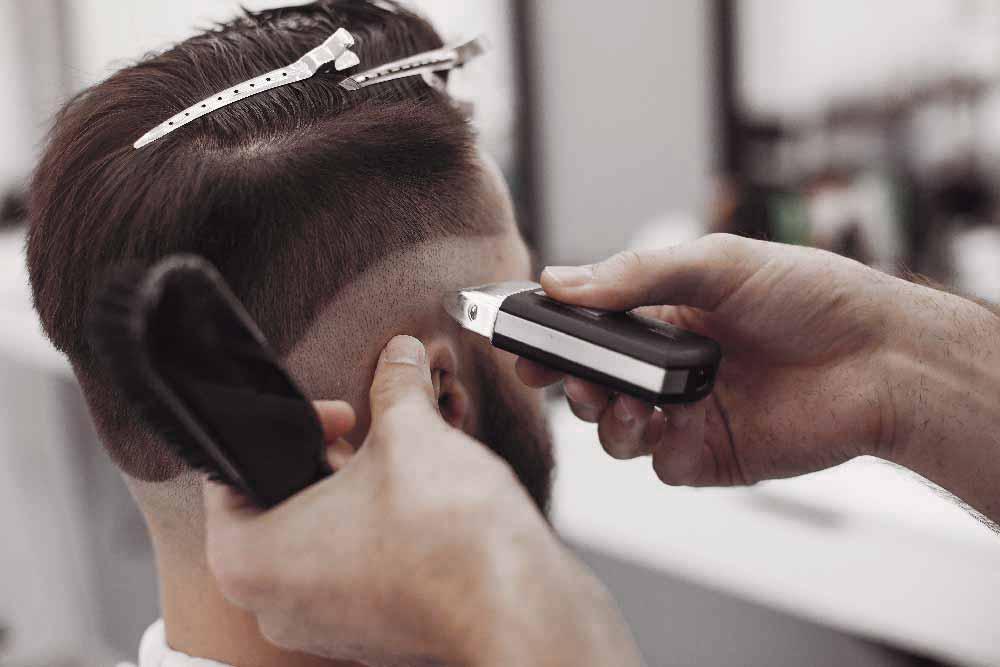 stylish-man-sitting-in-a-barbershop-Z7WU8LK.jpg